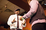 """Christopher Graves, left, and Charles Wright, right,  act out a scene as if they were Martin Luther King Jr. and Malcolm X during the """"Creative Arts as Activism – Social Justice-Themed Open Mic Night,"""" at Casa Nueva Restuarant and Cantina on January 20, 2016. ©Ohio University/Photo by Kaitlin Owens"""