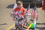 Colton Butler rides a bike in the 4th of July parade in Oxford, Miss. on Monday, July 4, 2011.