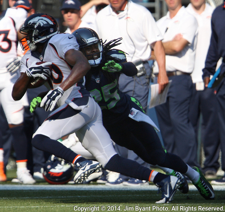 Seattle Seahawks  cornerback Richard Sherman tackle Denver Broncos wide receiver Emmanuel Sanders  (10) in the fourth quarter at CenturyLink Field in Seattle, Washington on September 21, 2014.The Seahawks won 26-20 in overtime.    ©2014. Jim Bryant Photo. All rights Reserved.