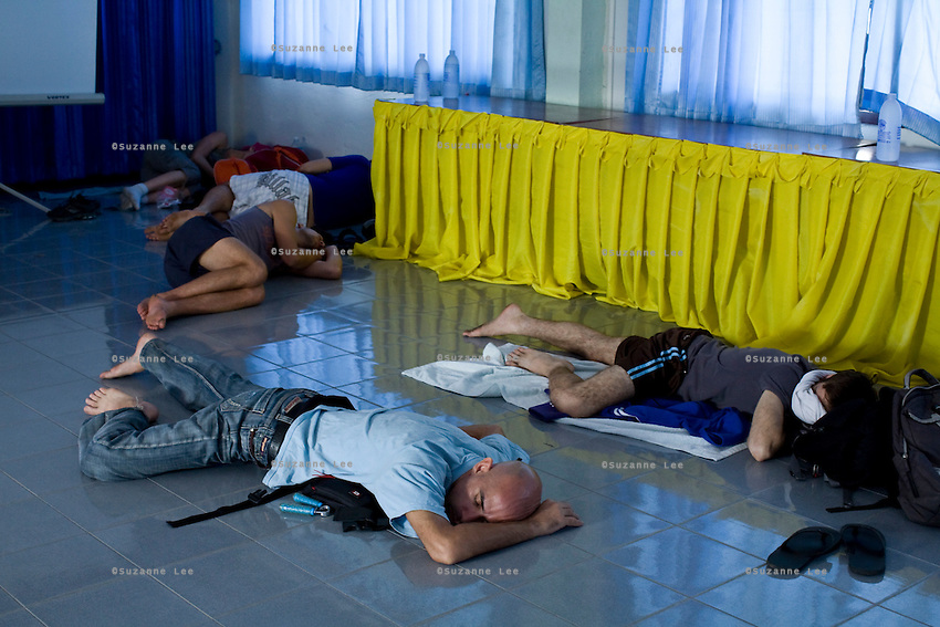 Shuki (front left) and his students rest in a hall before their fight at a Muay Thai competition in Phigit, a small town 300km north of Bangkok..(please refer to emailed captions for individual stories)..Shuki Rosenweig brings five fighters to fight in Phigit, a town 300km north of Bangkok, on 1st February 2010. Israelis Lital, Ilya, Gil and two other fighters, one from France and another from Brazil..Photo by Suzanne Lee for Chabad Lubavitch