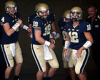 The Pitt quarterbacks take the field before the game. Pictured are Andrew Janocko (4), Pat Bostick (19), Tino Sunseri (12) and head coach Dave Wannstedt. The Pittsburgh Panthers defeat the New Hampshire Wildcats 38-16 at Heinz Field, Pittsburgh Pennsylvania on September 11, 2010.
