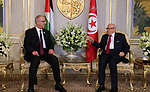 Palestinian Prime Minister Rami Hamdallah meets with Tunisia's President Beji Caid Essebsi in Capital of Tunis on April 5, 2017. Photo by Prime Minister Office