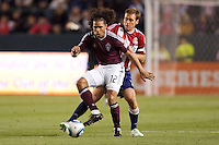 Colorado Rapids forward Quincy Amarikwa (12) defended tightly by CD Chivas USA defender Jimmy Conrad (12). The Colorado Rapids defeated CD Chivas USA 1-0 at Home Depot Center stadium in Carson, California on Saturday March 26, 2011...
