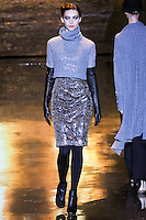 Emily Senko walks runway in a fog lace-knit pullover, and photon sequin & tulle dress, from the Badgley Mischka Fall 2011 fashion show, during Mercedes-Benz Fashion Week Fall 2011.