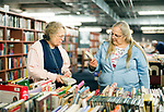Southbury, CT- 23 April 2017-042317CM08- Sisters,  Sharon Morkis, left, and Betsy Roberts, both of Woodbury pick out books during the Friends of the Southbury Public Library's annual Book Sale on Sunday.  All of the items in the sale were from donations, which featured thousands of books, DVD's, records and compact discs.  Approximately  2500 people came through the sale over the course of 4 days, said Edgar Mills vice chairman of the Friends of the Southbury Public Library.  Proceeds from the event will go towards various programs held at the library.  Christopher Massa Republican-American