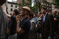 NEW YORK JUNE 13: People take part during a vigil in solidarity outside Manhattan's historic Stonewall Inn to express their support for the victims killed at Pulse nightclub in Orlando. New York June 13, 2016<br /> Photo by VIEWpress/Maite H. Mateo.