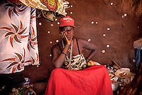 Witchdoctor Eartina Sabo (50) during a spiritual ceremony. She has been possessed by the spirit 'Masena' for the past 28 years and since then she has dedicated all her time to cure people. Her husband takes care of water, food, brushwood for fire and other house needs.