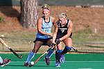 09 October 2015: Longwood's Edel Nyland (IRL) (7) and North Carolina's Ashley Hoffman (13). The University of North Carolina Tar Heels hosted the Longwood University Lancers at Francis E. Henry Stadium in Chapel Hill, North Carolina in a 2015 NCAA Division I Field Hockey match. UNC won the game 8-1.