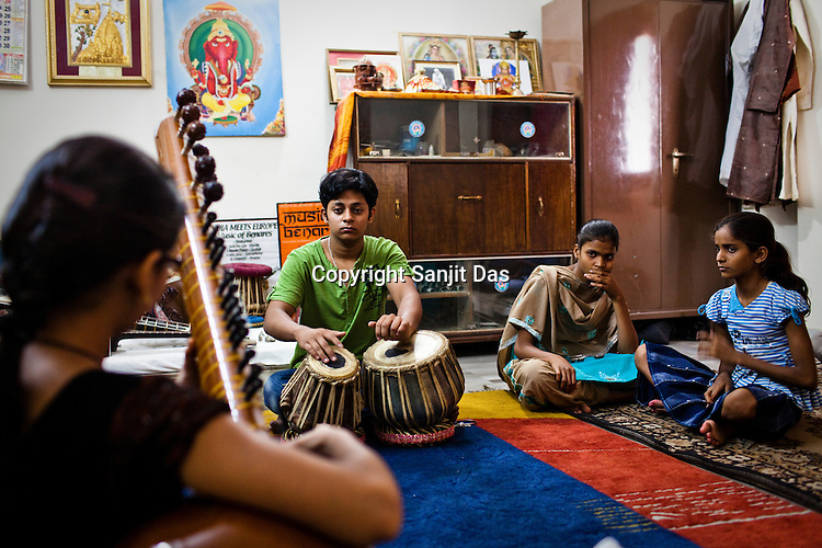 12 year old Aayushi Dwedi (left) plays sitar with tabla artist, Prashant Mishra in a class while other students look on in a music class at the Academy of Indian Classical Music in Varanasi in Uttar Pradesh, India. Photograph: Sanjit Das/Panos