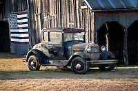 Model A Ford Coupe with Old Barn and American Flag