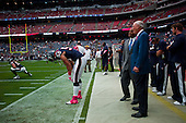 Houston, Texas<br /> October 2, 2011<br /> <br /> Team owner Bob McNair (blue jacket) and general manager and first as executive vice president, Rick Smith watch from the sidelines as the player warm up before the game. <br /> <br /> The Houston Texans defeated the Pittsburgh Steelers at the Reliant Stadium 17 to 10.