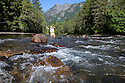 WA09153-00...WASHINGTON - Fly fishing on the Middle Fork of the Snoqualme River near North Bend. (MR# J9)