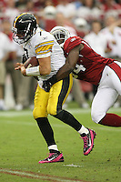 10/23/11 Glendale, AZ: Pittsburgh Steelers quarterback Ben Roethlisberger #7 and Arizona Cardinals linebacker Sam Acho #94 during an NFL game played at University of Phoenix Stadium between the Arizona Cardinals and the Pittsburgh Steelers. The Steelers defeated the Cardinals 32-20.