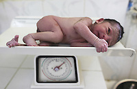 Newborn Afghanistan baby being weighed