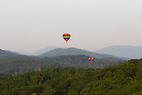 Hot air balloons move across the mountains in Madison County, VA. Photo/Andrew Shurtleff
