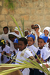Israel, Jerusalem, Ethiopian Orthodox children at the Church of the Holy Sepulchre on Palm Sunday