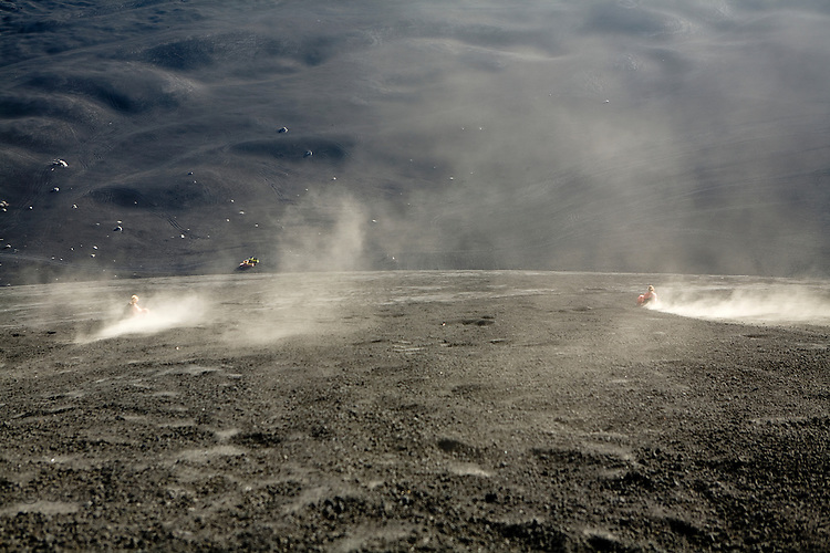View of two people boarding down the active volcano, Cerro Negro, Nicaragua
