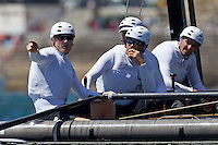 PORTUGAL, Cascais. 5th August 2011. America's Cup World Series. Practice day.  James Spithill (left) skipper of ORACLE Racing Spithill, discusses tactics with the crew.