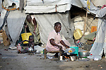 A displaced woman cooks inside a United Nations base in Malakal, South Sudan. More than 20,000 civilians have lived inside the base since shortly after the country's civil war broke out in December, 2013, and renewed fighting in 2015 drove an additional 5,000 people into the relative safety of the camp.