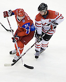 Nikita Klyukin (Russia - 21), Cody Hodgson (Canada - 18) - Canada defeated Russia 6-5 on Saturday, January 3, 2009, at Scotiabank Place in Kanata (Ottawa), Ontario during the 2009 World Junior Championship.