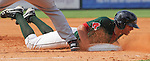 Third baseman Garin Cecchini (17) of the Greenville Drive slams into first base headfirst to avoid a pickoff tag during a game against the Rome Braves on July 8, 2012, at Fluor Field at the West End in Greenville, South Carolina. (Tom Priddy/Four Seam Images)
