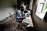 Lab technician Luambo Mukando uses the microscope in lab of the United Methodist hospital in the Congolese village of Tunda.