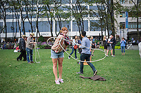 Wannabe cowboys practice their lassoing before hundreds of New Yorkers and visitors dance up a storm in Bryant Park in New York on Wednesday, September 25, 2013 during the third and last square dancing session of the year in the park. As incongruous as it sounds square dancing's popularity in New York ebbs and flows with it reaching its peak after World War II where thousands would participate in large dances held in Central Park. (© Frances M. Roberts)