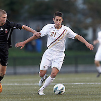 Boston College midfielder/defender Colin Murphy (21) brings the ball forward. Brown University (black) defeated Boston College (white), 1-0, at Newton Campus Field, October 16, 2012.