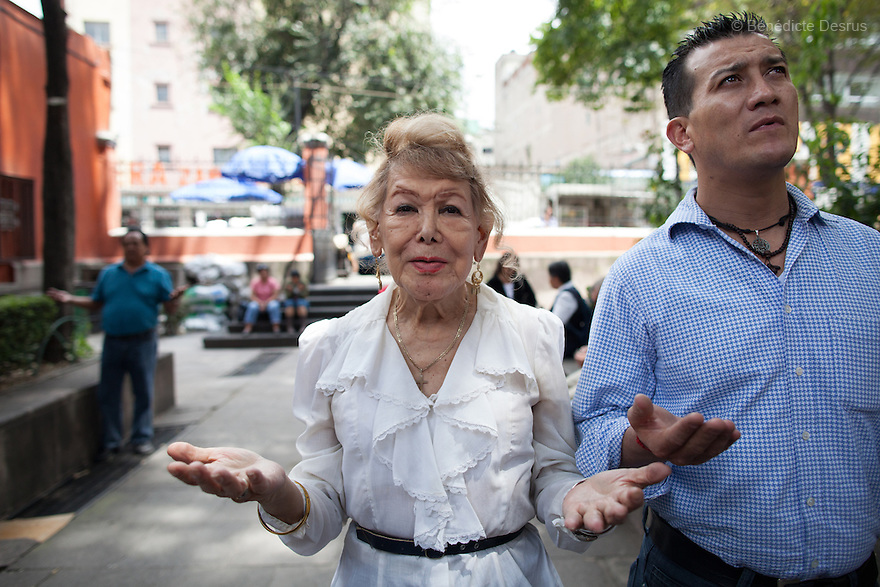 """September 9, 2012 - Mexico City, Mexico - Samantha and her friend Leo pray outside the church in Mexico City. Samantha Flores is an 80-year-old transgender woman from Veracruz, Mexico. She is a prominent social activist for LGBTQI rights and is the founder of the non-profit organization """"Laetus Vitae"""", a day shelter for elderly gay people in Mexico City. Senior citizens in general are many times prone to neglect and abandonment by their families, leaving them all but invisible. Their plight can be even worse if they are homosexual. Photo credit: Bénédicte Desrus"""