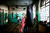 Warsaw 03.2009 Poland<br /> Since the early 50' ties &quot;Gwardia&quot; has been famous for bringing up world boxing champions. The famed sports hall located by pl. Zelaznej Bramy in Warsaw witnessed trainings of Jerzy Kulej, the Skrzeczowie brothers, last Polish olympic champion Jerzy Rybicki or its most recent star Krzysztof &quot;Diablo&quot; Wlodarczyk. The club prides of numerous sport achievements, among others, 15 olympic medals (6 gold), over 60 medals from European and World Championships and over 100 from Championships of Poland.<br /> Today, only three small training halls remain from the former times of glory.<br /> One of the most famous in Polish history boxing section of Warsaw's &quot;Gwardia&quot; awaits its liquidation. This &quot;Mecca&quot; of Polish boxing is to be replaced by a huge supermarket,  decisions imposed by Warsaw authorities.<br /> ( Photo: Adam Lach / Napo Images )<br /> <br /> Juz od wczesnych lat 50. Gwardia slynela z wychowywania swiatowych mistrzow bokserskich. W hali przy pl. Zelaznej Bramy trenowali Jerzy Kulej, bracia Skrzeczowie, ostatni polski mistrz olimpijski w boksie Jerzy Rybicki czy obecna gwiazda ringu Krzysztof &quot;Diablo&quot; Wlodarczyk. Klub moze poszczycic sie wieloma osiagnieciami sportowymi, do kt&oacute;rych przede wszystkim zaliczyc nalezy: 15 medali olimpijskich (w tym 6 zlotych), ponad 60 medali Mistrzostw Swiata i Europy i ponad 1000 medali Mistrzostw Polski. Teraz z dawnej swietnosci pozostaly zaledwie trzy male salki. Jedna z najslyniejszych w historii Polski sekcja bokserska Gwardii Warszawa ma byc zlikwidowana. Decyzja wladz Warszawy, te swego rodzaju mekke polskiego boksu ma zastapic wielki market<br /> (Fot Adam Lach / Napo Images )