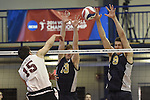 27 APR 2014: Matt Elias (13) and Chad Albert (9) block against Springfield College during the Division III Men's Volleyball Championship held at the Kennedy Sports Center in Huntingdon, PA. Springfield defeated Juniata 3-0 to win the national title.  Mark Selders/NCAA Photos