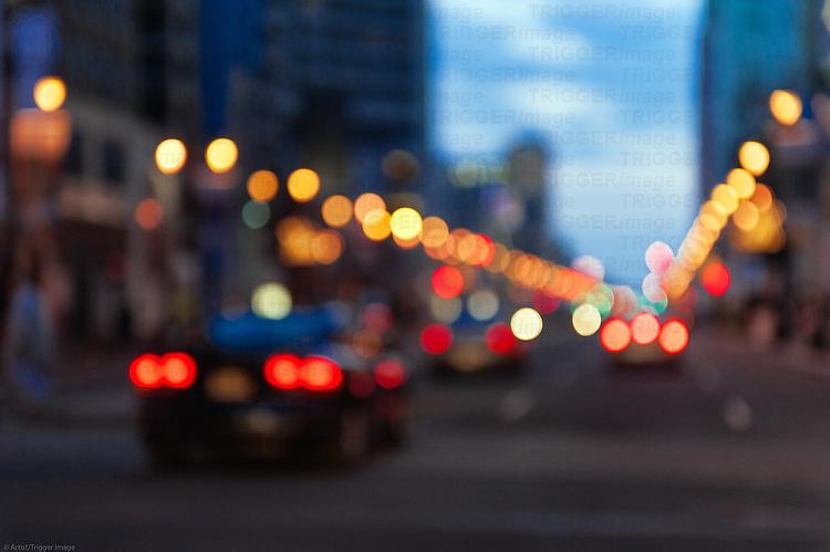Blurred urban street traffic.