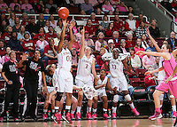 STANFORD, CA - February 10, 2013: Stanford Cardinal's Alex Green gets cheered on by Mikaela Ruef, Amber Orrange, Chiney Ogwumike and team during Stanford's game against Arizona State at Maples Pavilion in Stanford, California.  The Cardinal defeated the Sun Devils 69-45.