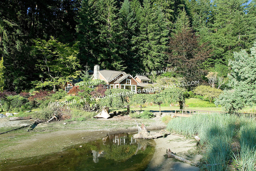 Perched on the edge of Puget Sound, this waterfront weekend vacation retreat on Washington State's Vashon Island sits down in a protected, west-facing hollow with its own private beach and 5 acres of beautiful, established gardens.