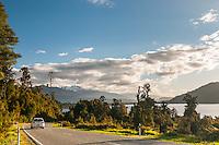 Car on road at Lake Ianthe, West Coast, South Westland, South Island, New Zealand