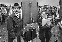 Bookies taking bets during the harness racing - a form of horse racing - at Stanhope, County Durham.