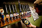 Travis Mann fills a growler at Mammoth Brewing Company in Mammoth Lakes, Calif., January 28, 2011.
