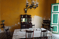 Dining room with colonial antique furniture at Hacienda Yaxcopoil, Yucatan, Mexico.