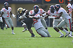 Vanderbilt running back Jerron Seymour (18) is tackled by Ole Miss' Bryon Bennett (95) in Nashville, Tenn. on Saturday, September 17, 2011. Vanderbilt won 30-7..