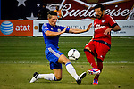 Chelsea FC playerSam hutchinson (L) fights for the ball with Paris Saint-German FC player Ezequiel Lavezzi during their soccer match at the Yankee Stadium in New York, July 22, 2012. Photo by Eduardo Munoz Alvarez / VIEW.