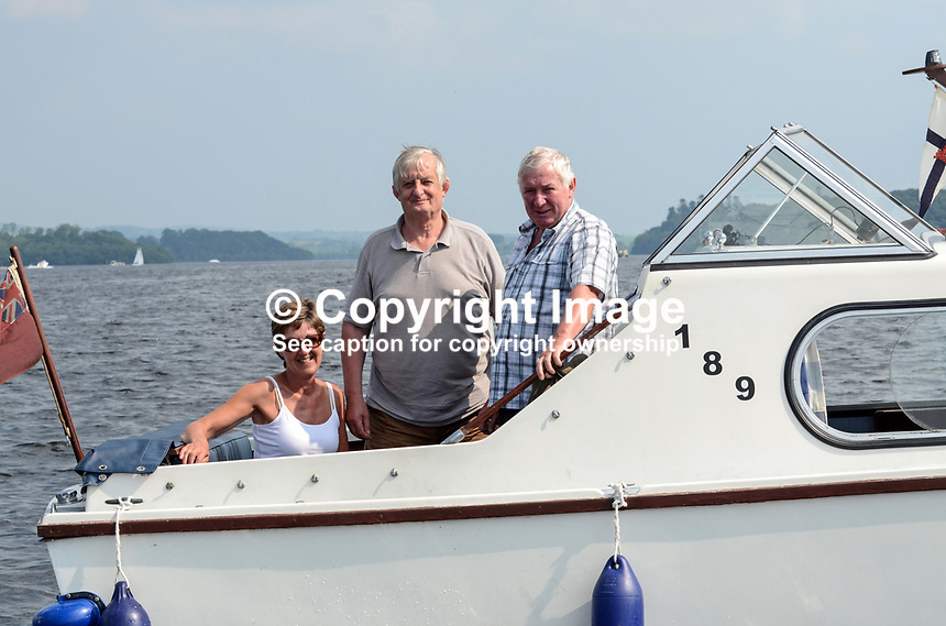 Alan Cooper, onwer, cruiser, Mercador, centre, relaxing with friends, Davy and Diane Clark, on Lough Erne, Co Fermanagh, N Ireland, UK, 20th July 2013, The are all from Enniskillen. 201307202809.   <br /> <br /> Copyright Image from Victor Patterson, 54 Dorchester Park, Belfast, UK, BT9 6RJ<br /> <br /> t1: +44 28 9066 1296<br /> t2: +44 28 9002 2446<br /> m: +44 7802 353836<br /> <br /> e1: victorpatterson@me.com<br /> e2: victorpatterson@gmail.com<br /> <br /> www.victorpatterson.com<br /> <br /> IMPORTANT: Please see my Terms and Conditions of Use at www.victorpatterson.com