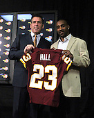 Ashburn, VA - March 3, 2009 -- Washington Redskins head coach Jim Zorn, left, and newly re-signed cornerback DeAngelo Hall hold up a jersey with Hall's number on it after speaking to reporters about Hall's recent signing of a 6 year, $55 million contract.  $23 million of that is guaranteed and $30 million will be paid in the first 3 years. .Credit: Ron Sachs / CNP