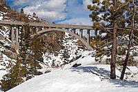 Historic US 40 passes over the Donner Summit at McGlashan Point on its way to Donner Lake and Truckee. The concrete arch bridge was completed in 1925 and served as the major east-west transcontinental route between San Francisco, California, and Atlantic City New Jersey until it was replaced by Interstate 80 in the mid 1960's. Today the road is a scenic bypass to the busy interstate and an access road to nearby ski resorts.