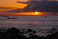Outrigger canoe paddlers off Kaanapali Beach at sunset; Kaanapali was the first planned resort in the Hawaiian Islands.