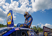 Jun 6, 2016; Epping , NH, USA; NHRA funny car driver Ron Capps climbs from the emergency roof escape hatch during the New England Nationals at New England Dragway. Mandatory Credit: Mark J. Rebilas-USA TODAY Sports