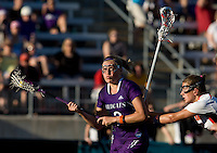 Laura Merrifield (9) of Maryland tries to defend Danielle Spencer (2) of Northwestern during the NCAA Championship held in Johnny Unitas Stadium at Towson University in Towson, MD.  Maryland defeated Northwestern, 13-11, to win the title.