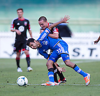 Casey Townsend (16) of D.C. United fights for the ball with Steven Beitashour (33) of the San Jose Earthquakes during a Major League Soccer game at RFK Stadium in Washington, DC.  D.C. United defeated San Jose Earthquakes, 1-0.