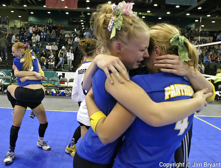 Mead players (back left) Cassie Dobson is hugged by Amy Herron as lacey Anderson( m) hugs Debra DeFelice as they celebrate their 25-24, 25-15 and 25-23 win over the Eisenhower Cadets in the 4A Volleyball Champion game held in Everett, Wa.  Jim Bryant photo
