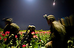 Members of the 82nd Airborne's 1/508 Parachute Infantry Regiment scramble after being accidentally illuminated by a friendly flare after staging a nighttime air assault into Sangin, Helmand province, the largest air assault in Afghanistan since the beginning of the war, on Thursday, April 5, 2007.