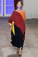 Vika Falileeva walks the runway in an orange/red/navy color black silk v-neck kaftan , by Tommy Hilfiger for the Tommy Hilfiger Spring 2012 Pop Prep Collection, during Mercedes-Benz Fashion Week Spring 2012.